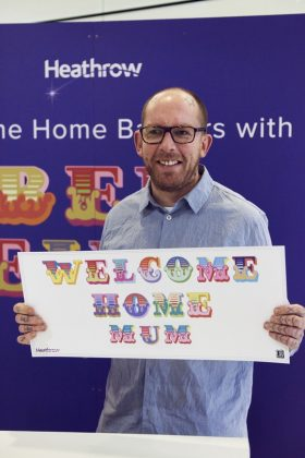 Street artist Ben Eine creates Christmas welcome banners for Heathrow passengers