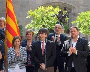 Catalonia defies Madrid, sets date for independence vote