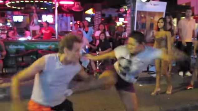 This Thai woman (pictured) decides to give a tourist a lesson he'll never forget