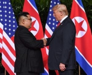 History in the making: Trump and Kim Jong-un shake hands in Singapore