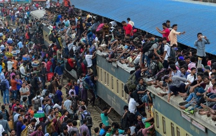 Bangladeshi Muslims storm overcrowded trains to get home for holiday