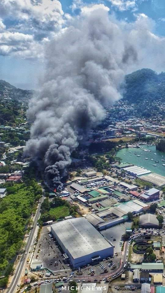 Seychelles Public Bus Depot and ferry boat on fire