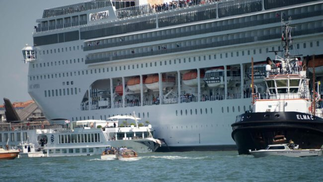 MS Opera Cruise cruise ship slams into wharf in Venice while tourist flee