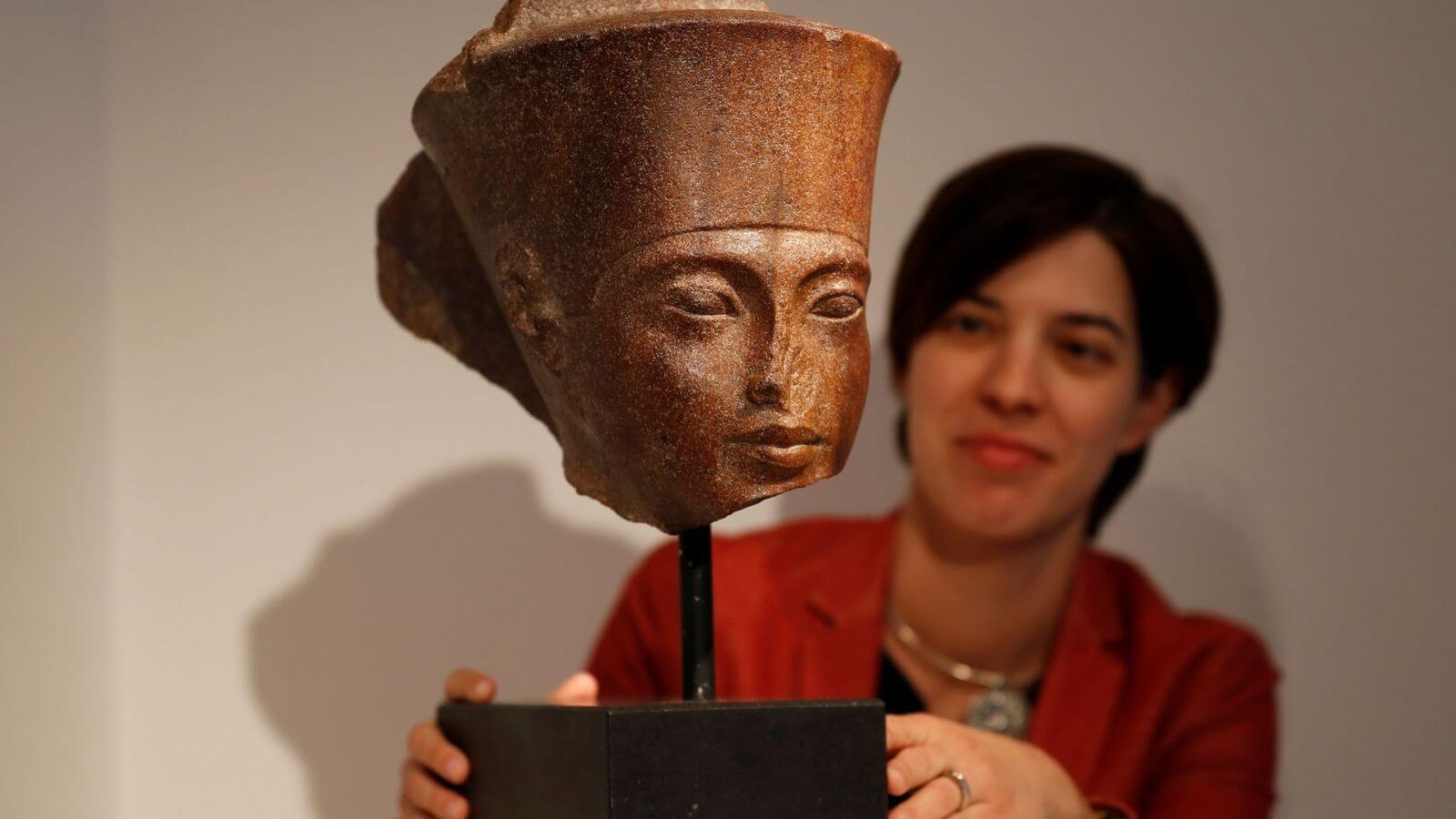 Egypt irked by sale of 'stolen' King Tut bust at Christie's auction in London
