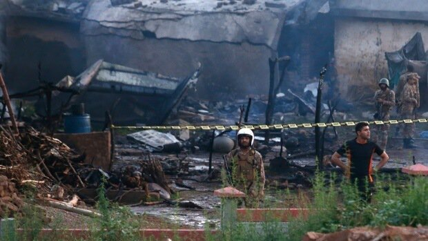 17 people killed when plane crashes into residential area in Pakistan
