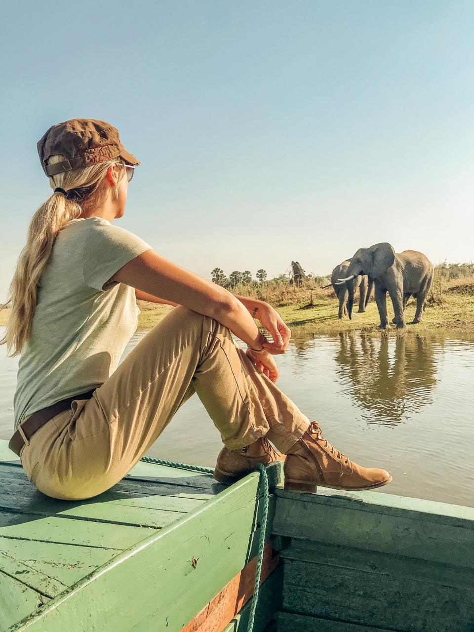 Malawi - Co-founder of We Are Travel Girls, Vaness Rivers in Malawi on a river safari