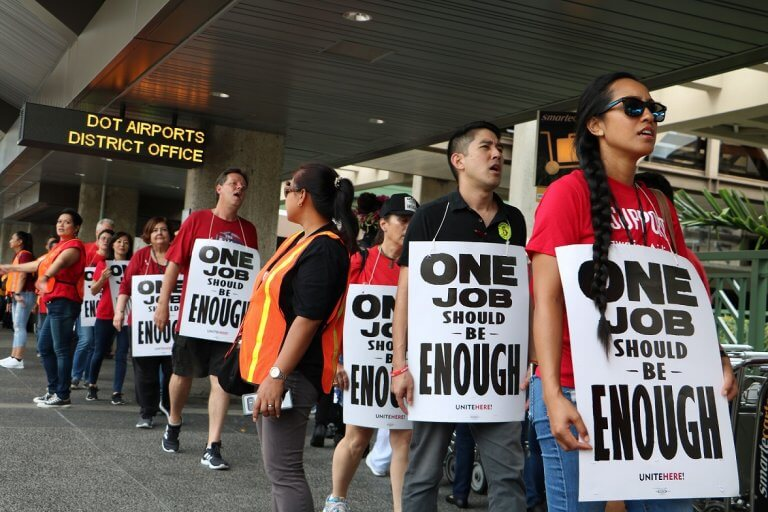 Honolulu airport union workers rally for better wages and benefits